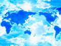 世界地図と青空の写真