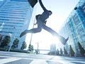ジャンプをするビジネスマンの写真