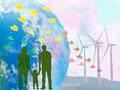手をつなぐ家族と風力発電のイメージの写真