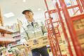 スーパーでマネージャーとして働くシニア男性(商品補充)の写真